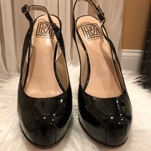 Black patent leather sling back pumps